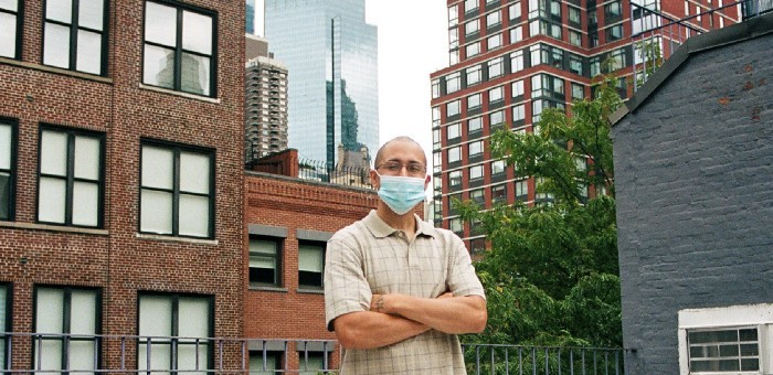 Photo of Tomas Correra in front of buildings in NYC