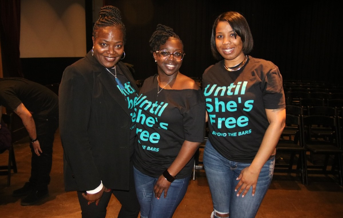 "Beyond the Bars organizers posing in their ""Until She's Free"" shirts"